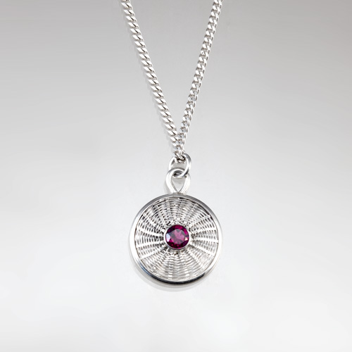 Sunburst Weave Pendant in sterling silver with rhodolite garnet